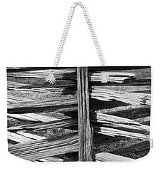 Weekender Tote Bag featuring the photograph Stacked Fence by Lynn Palmer