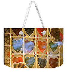 Weekender Tote Bag featuring the photograph Stained Glass Hands And Hearts by Kathy Barney