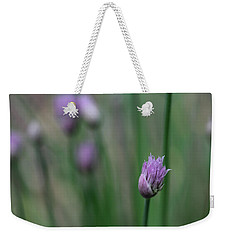 Weekender Tote Bag featuring the photograph Not Just A Pretty Flower by Debbie Oppermann
