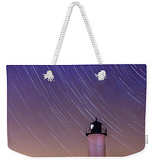 Stars Trailing Over Lighthouse Weekender Tote Bag by Jeff Folger