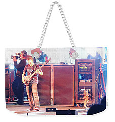 Weekender Tote Bag featuring the photograph Stephan The Bass Player by Aaron Martens
