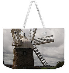 Weekender Tote Bag featuring the photograph Still Turning In The Wind by Tracey Williams