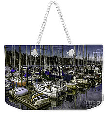 Weekender Tote Bag featuring the photograph Stirring The Sky by Jean OKeeffe Macro Abundance Art