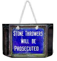 Weekender Tote Bag featuring the photograph Stone Throwers Be Warned by Adrian Evans