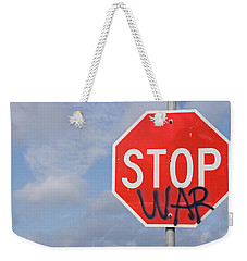 Weekender Tote Bag featuring the photograph Stop War Sign by Charles Beeler