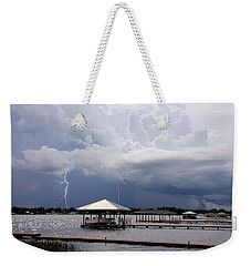 Weekender Tote Bag featuring the photograph Storm Over Clay Lake by Rosalie Scanlon