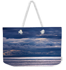 Weekender Tote Bag featuring the photograph Storm Supremacy by Jordan Blackstone