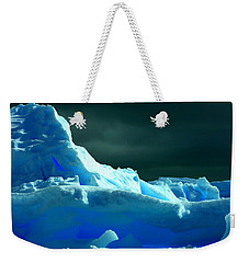 Weekender Tote Bag featuring the photograph Stormy Icebergs by Amanda Stadther