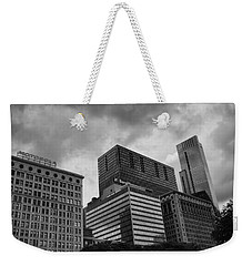 Weekender Tote Bag featuring the photograph Stormy Skies by Miguel Winterpacht