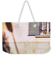 Weekender Tote Bag featuring the photograph Street Lamp Shadow And Window by Silvia Ganora
