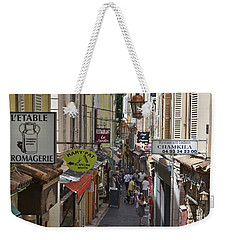 Weekender Tote Bag featuring the photograph Street Scene In Antibes by Allen Sheffield