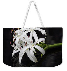 Weekender Tote Bag featuring the photograph String Lily #1 by Paul Rebmann