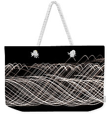 Weekender Tote Bag featuring the photograph String Theory by Rachel Cohen