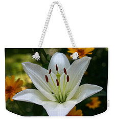 Weekender Tote Bag featuring the photograph Summer Lily by Denyse Duhaime
