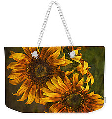 Weekender Tote Bag featuring the photograph Sunflower Trio by Priscilla Burgers