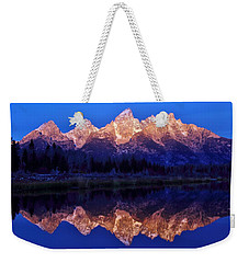 Weekender Tote Bag featuring the photograph Sunrise Glow by Benjamin Yeager