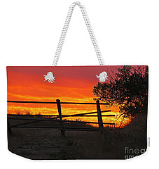 Weekender Tote Bag featuring the photograph Sunset At Bear Butte by Mary Carol Story