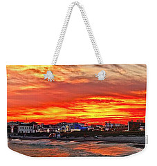 Sunset At The Music Pier Weekender Tote Bag by Nick Zelinsky