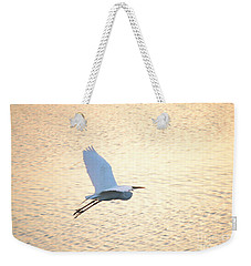 Weekender Tote Bag featuring the photograph Sunset Flight by Carol  Bradley