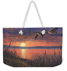 Weekender Tote Bag featuring the painting Sunset Flight by Kim Lockman