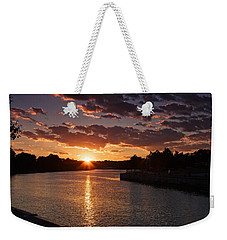 Weekender Tote Bag featuring the photograph Sunset On The River by Dave Files