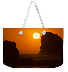 Weekender Tote Bag featuring the photograph Sunset Over The Pacific Ocean With Rock Stacks by Jeff Goulden