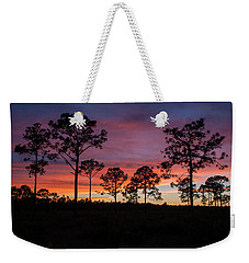 Weekender Tote Bag featuring the photograph Sunset Pines by Paul Rebmann