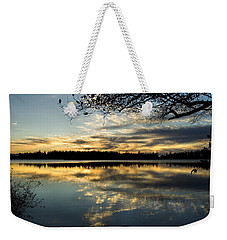 Weekender Tote Bag featuring the photograph Sunset Reflection by Yulia Kazansky