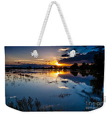 Weekender Tote Bag featuring the photograph Sunset Reflections by Steven Reed