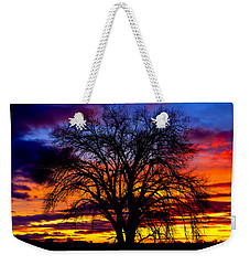 Weekender Tote Bag featuring the photograph Sunset Silhouette by Greg Norrell