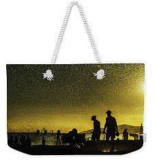 Weekender Tote Bag featuring the photograph Sunset Silhouette Of People At The Beach by Peter v Quenter