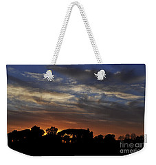 Weekender Tote Bag featuring the photograph Sunset by Simona Ghidini