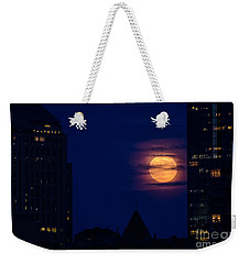 Weekender Tote Bag featuring the photograph Super Moon Rises by Mike Ste Marie