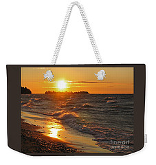 Weekender Tote Bag featuring the photograph Superior Sunset by Ann Horn