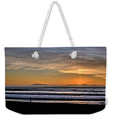 Weekender Tote Bag featuring the photograph Surf Fishing by Michael Gordon