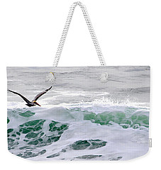 Weekender Tote Bag featuring the photograph Surf N Pelican by AJ  Schibig