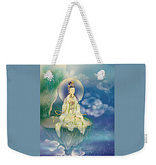 Weekender Tote Bag featuring the photograph Sutra-holding Kuan Yin by Lanjee Chee