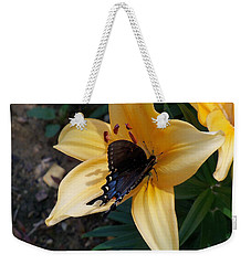 Weekender Tote Bag featuring the photograph Swallowtail On Asiatic Lily by Kathryn Meyer