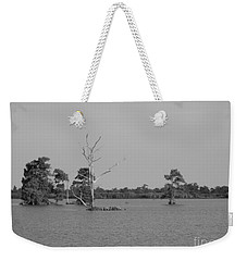 Weekender Tote Bag featuring the photograph Swamp Cypress Trees Black And White by Joseph Baril