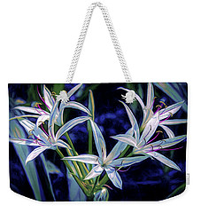 Weekender Tote Bag featuring the photograph Swamp Lilies by Steven Sparks
