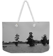 Weekender Tote Bag featuring the photograph Swamp Tall Cypress Trees Black And White by Joseph Baril