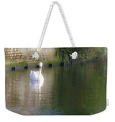 Weekender Tote Bag featuring the photograph Swan In The Canal by Victoria Harrington