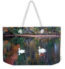 Weekender Tote Bag featuring the photograph Swans by Karen Silvestri