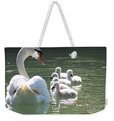 Weekender Tote Bag featuring the photograph Swans  by Rogerio Mariani