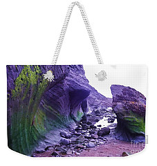 Weekender Tote Bag featuring the photograph Swirl Rocks by John Williams