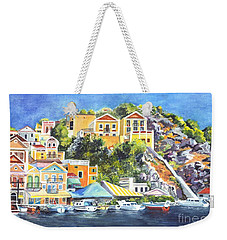 Weekender Tote Bag featuring the painting Symi Harbor The Grecian Isle  by Carol Wisniewski