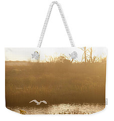 Weekender Tote Bag featuring the photograph Taking Off Into A Golden Sunrise by Carol Lynn Coronios