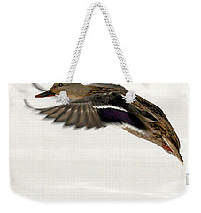 Weekender Tote Bag featuring the photograph Taking Off by John Telfer