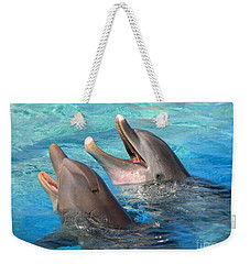 Weekender Tote Bag featuring the photograph Talking Dolphins by Kristine Merc
