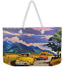 Taos Joy Ride With Yellow And Orange Trucks Weekender Tote Bag by Art West